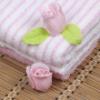 Stock Photo: Convolute towels and soap as flower of rose
