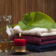 Stock Photo: Convolute towels and candle