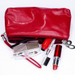 Stock Photo: Red cosmetic bag full of items