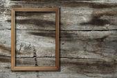 Marco sobre fondo de madera — Foto de Stock
