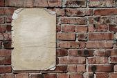 Documento sobre brickwall — Foto de Stock