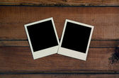 Photos on wooden wall — Stock Photo