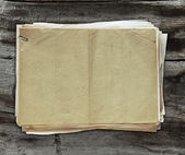 Old papers on wooden background — Stok fotoğraf