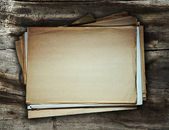 Old papers on wooden background — Stockfoto