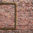 Photo frame on brick wall — Stockfoto #4232416