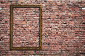 Photo frame on brick wall — Stock Photo
