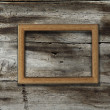 Frame on wooden background - Stock Photo