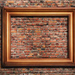 Photo frame on brick wall - Stock Photo