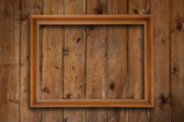 Frame on wooden wall — Stock Photo