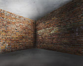 Corner of old dirty interior with brick wall — Stock Photo