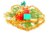 Christmas gifts on fur-tree branches — Stock Photo
