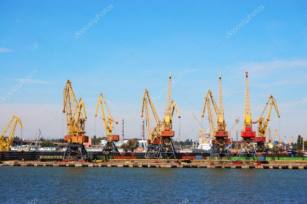 The review of a mooring of trading port with elevating cranes  Stock Photo #4213345