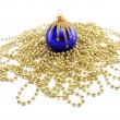 Royalty-Free Stock Photo: Dark blue Christmas sphere with a beads