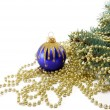 Fur-tree with a Christmas ball and a beads — Stock Photo
