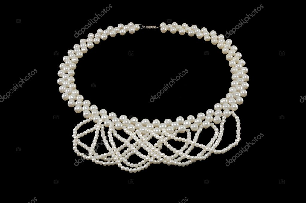 White pearl necklace on a black background — Stock Photo #4697469