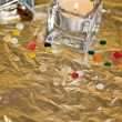 Christmas candle & baubles on a gold background — Stock Photo #4266948