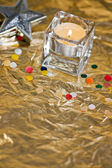 Christmas candle & baubles on a gold background — Foto de Stock