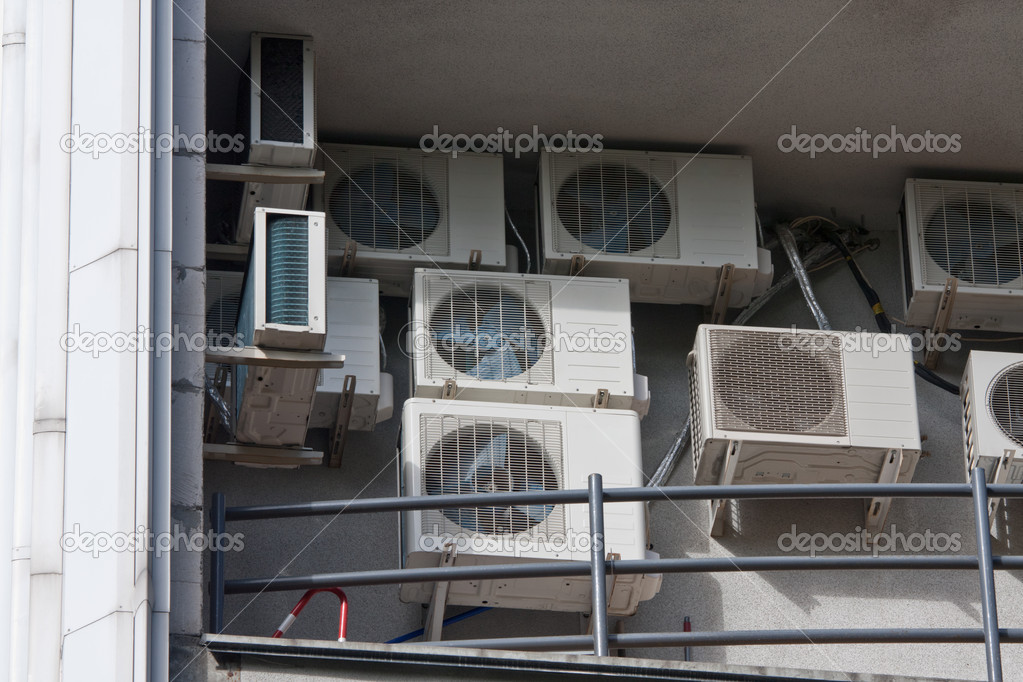 Office building and air conditioners mounted on the wall — Stock Photo #4877582