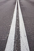 Double white lines on road — Stok fotoğraf