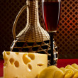 Stock Photo: Red wine glass and cheese