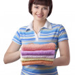 Woman holding clean towels — Stock Photo