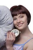 Sleepy woman is holding alarm clock — Stock Photo