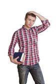 Student myslet a držet knihy — Stock fotografie