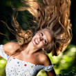 Young woman with fluttering hair — Foto de Stock