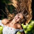 Young woman with fluttering hair - Stock Photo