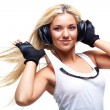 Stock Photo: Young woman with big headphones