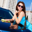 Stock Photo: Young woman washing car