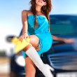 Young woman with car - Stock Photo