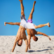 Two sportsmans on beach - Stock Photo