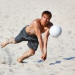 Young man catching ball — Stock Photo