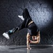 Young strong man break dance - Stock Photo