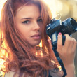 Royalty-Free Stock Photo: Young woman photographer