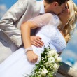 Stock Photo: Young wedding couple kissing