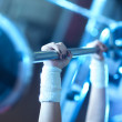 Young woman weight training — Stock Photo