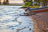 Lake bank with boats — Stock Photo