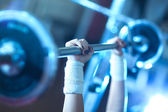 Young woman weight training — Foto Stock