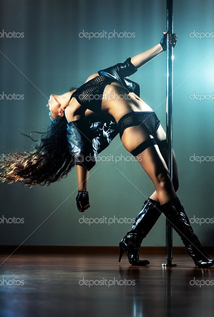 Young sexy pole dance woman. — Stock Photo #4697995