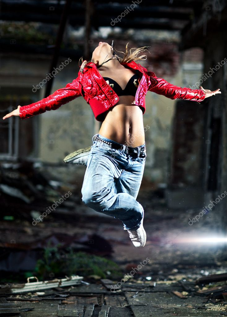 Young woman dancing on industrial background. — Stock Photo #4698036