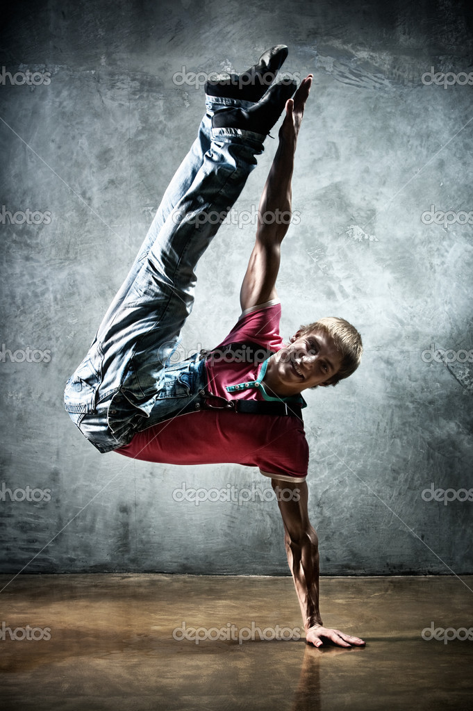 Young man break dance. On wall background. — Stock Photo #4698182