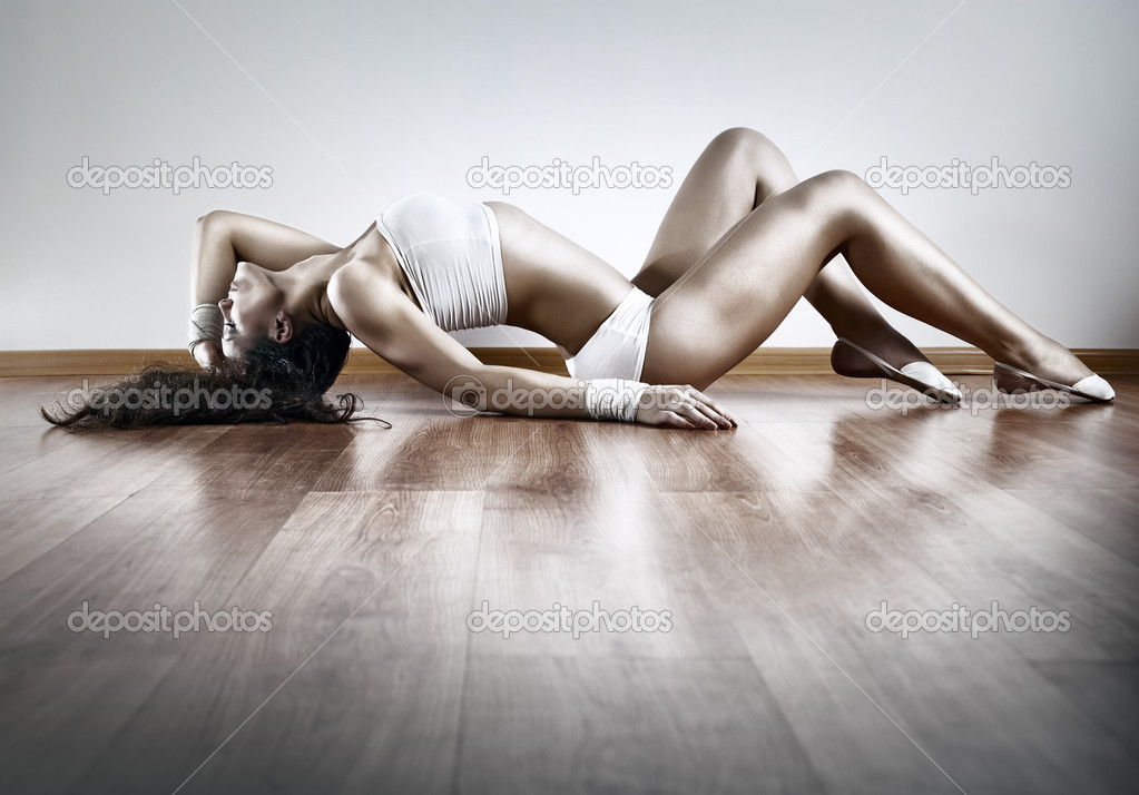 Young sexy sports woman stretching on floor. — Stock Photo #4698224