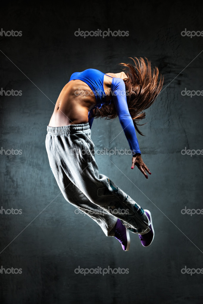 Young woman dancer jumping. On wall background. — Stock Photo #4698243