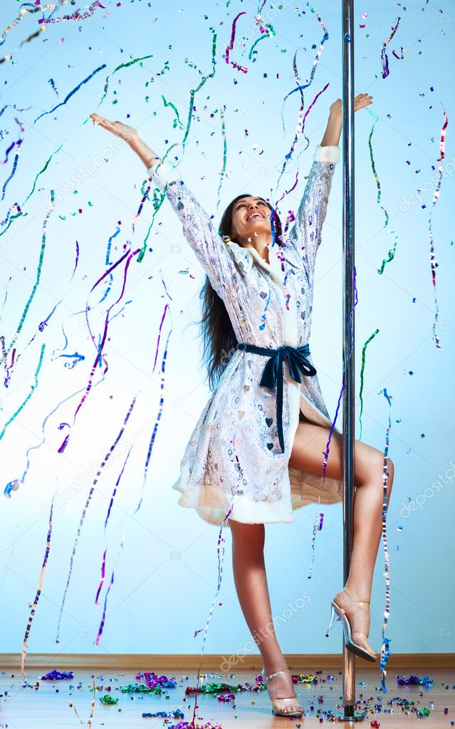 Young pole dance woman in new year clothes celebrating. — Stock Photo #4698267