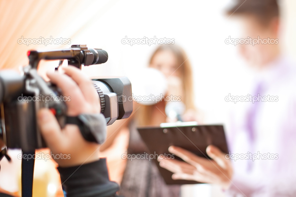 Cameraman at work. Shallow dof effect. — Stock Photo #4698288