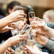 Toast. Many hands with champagne glasses. — Stock Photo