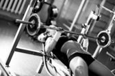 Young woman weight training — Stockfoto