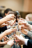 Toast. Many hands with champagne glasses. — Foto Stock